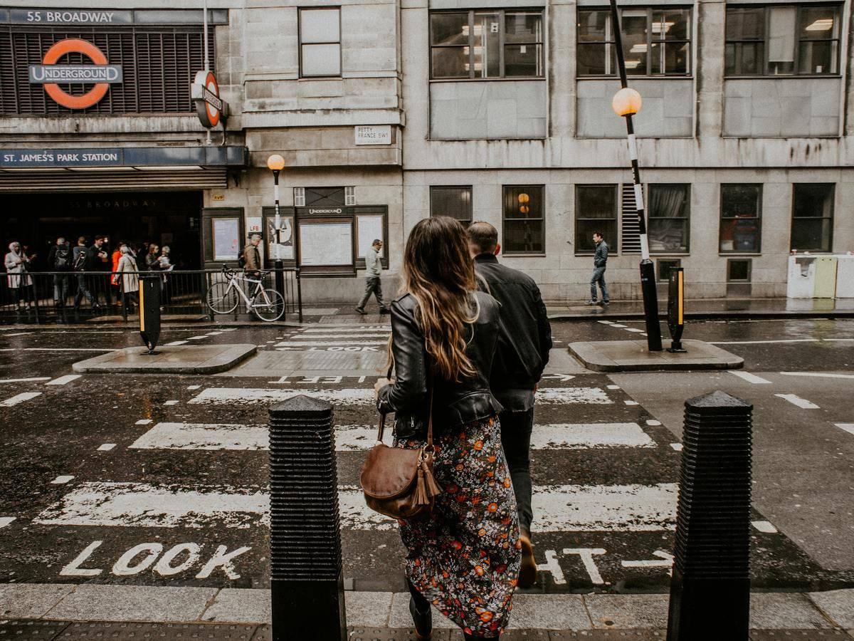 Woman walking at crosswalk