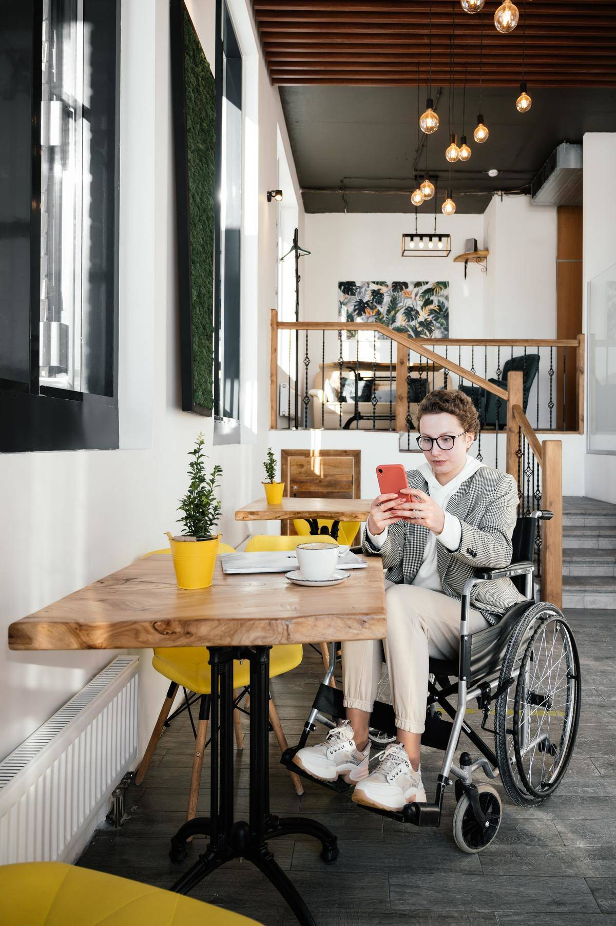 Woman in wheelchair looks at her phone