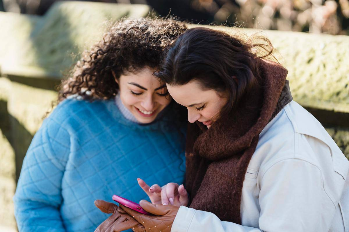 Women laugh at phone