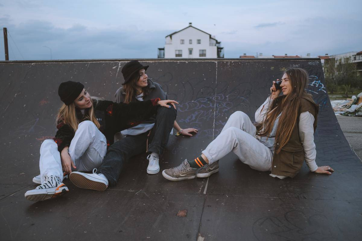 Young people take pictures on roof