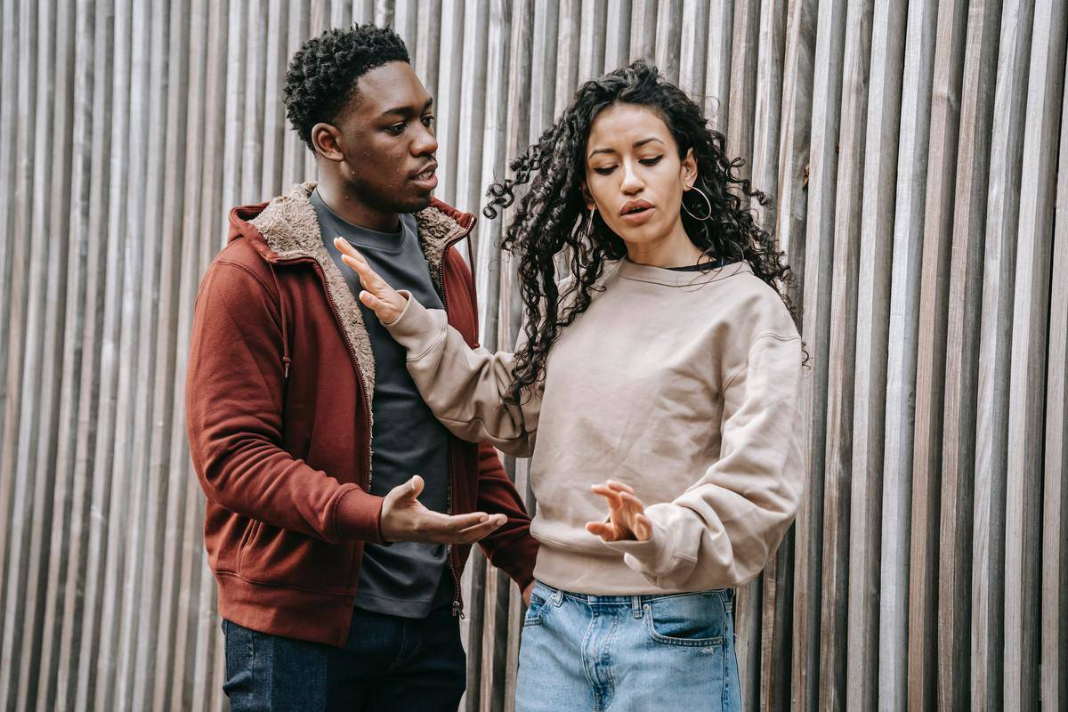 Couple in fight outside talking