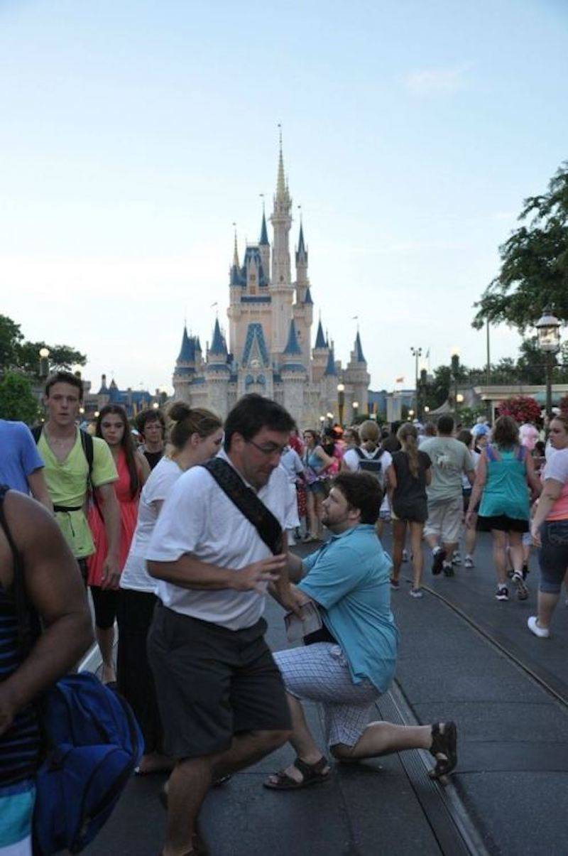 Man accidentally photobombing a proposal in front of Cinderella's Castle at Disney
