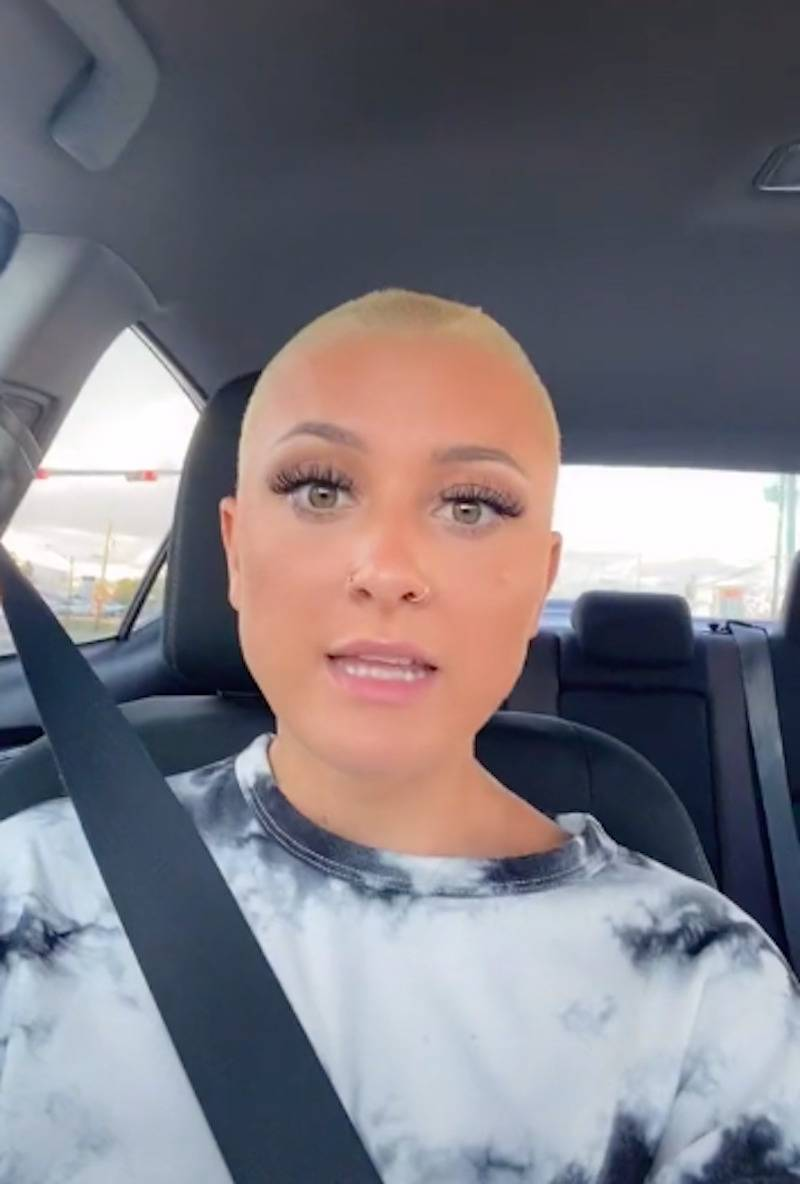 Ken looks at the camera in her car during the beginning of her TikTok video.