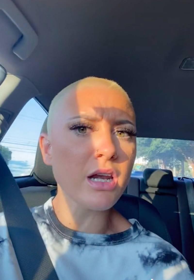 A screenshot of Ken near the end of her TikTok video in her car.