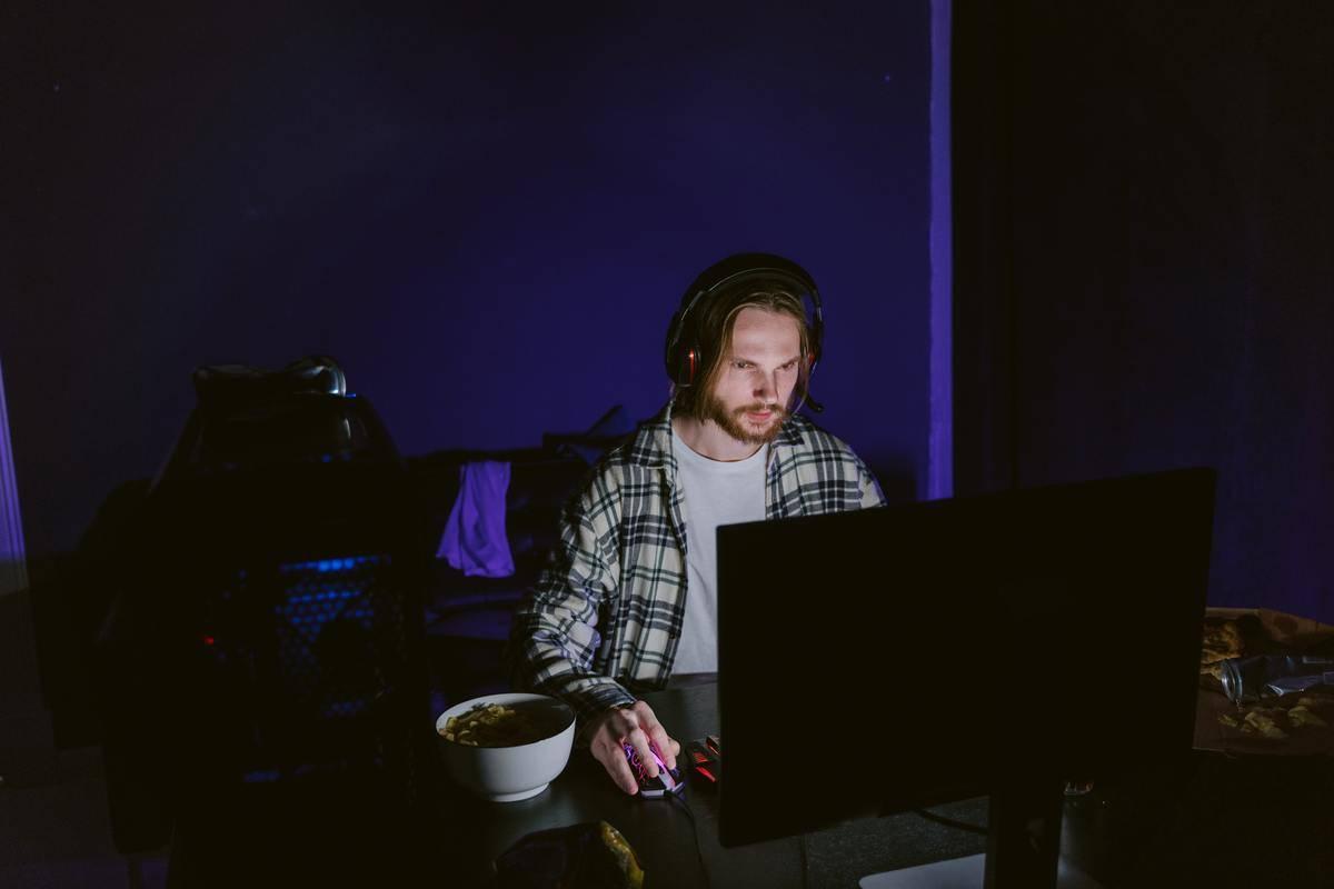 Man with headphones on in dark