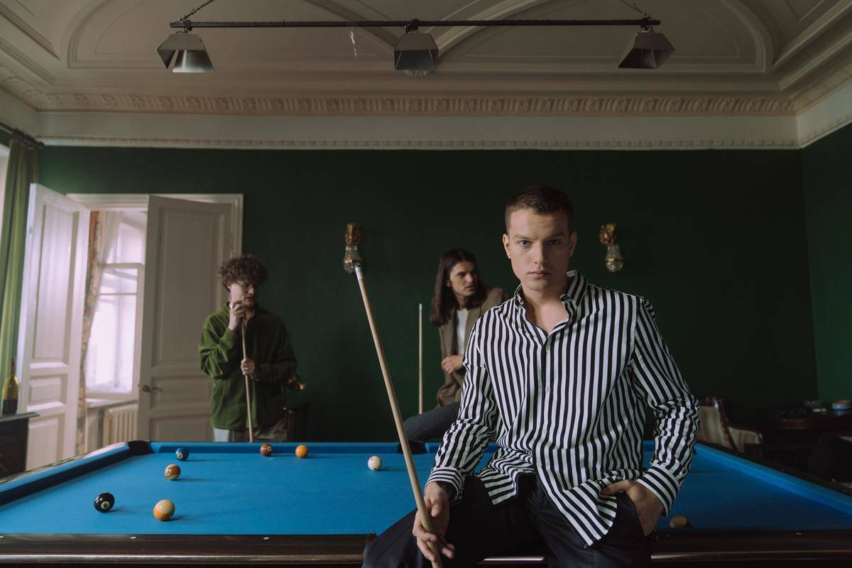 People play pool indoors.