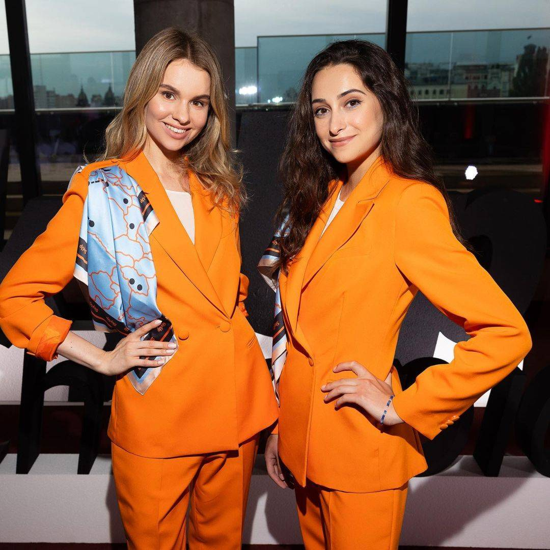 Two flight attendants wearing the new uniform of SkyUp Airlines.