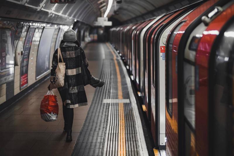 Woman in train station walking